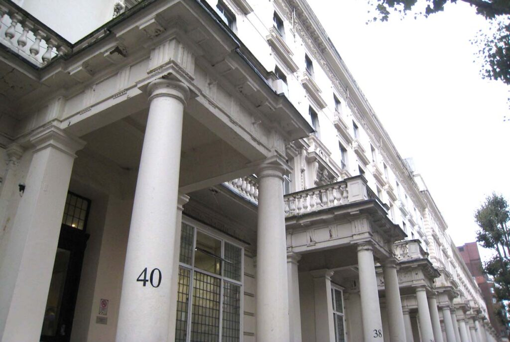 View of the white building located at Inverness Terrace 40 in London on the website A Better Version