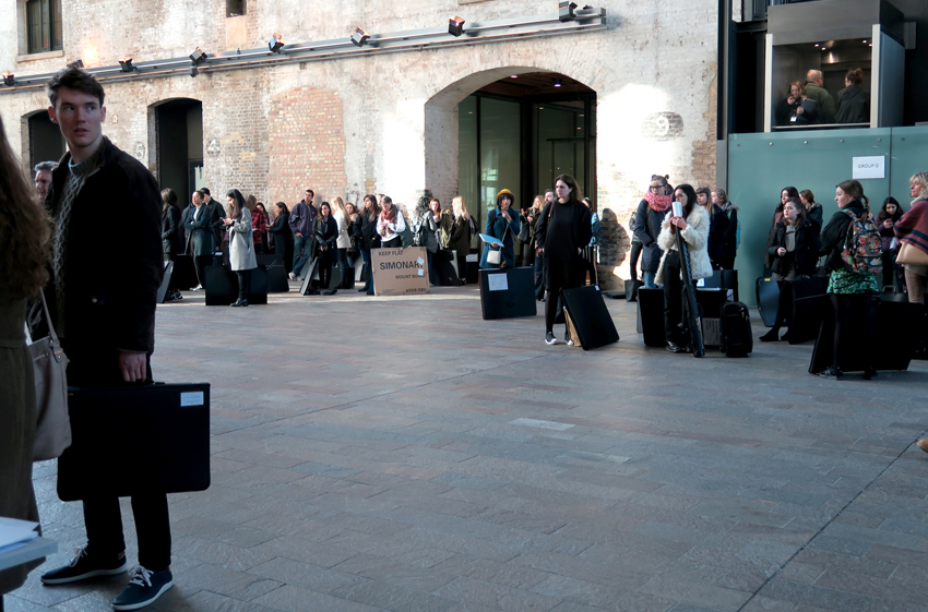 Group of young people lining up with their portfolios at CSM Kings Cross in London on the website A Better Version