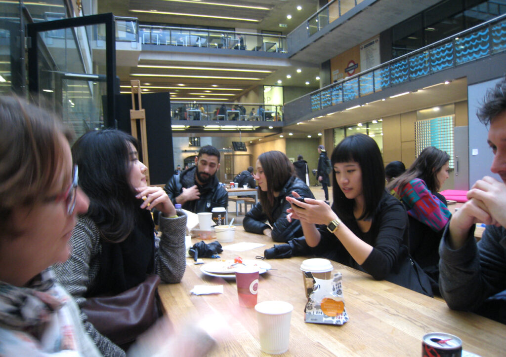 Group of students at table at CSM Kings Cross in London on the website A Better Version
