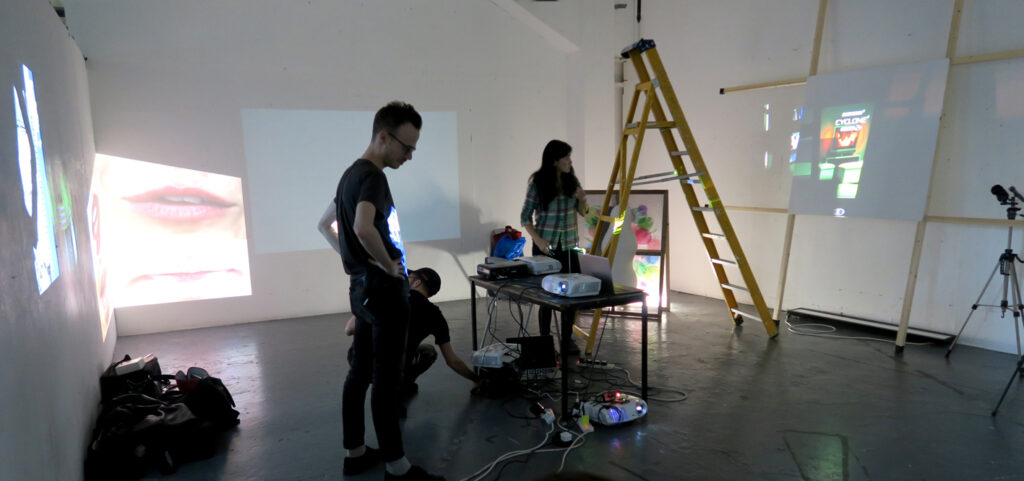 A man and a woman while building an exhibition at CSM studios in Archway London on the website A Better Version
