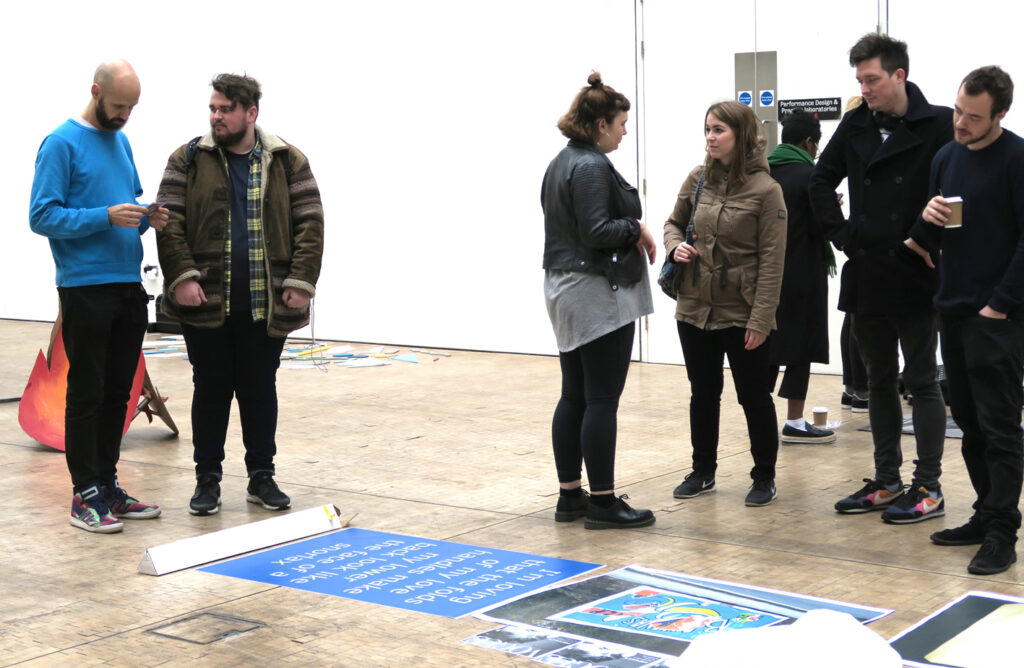Group of students and a teacher while building an exhibition at CSM in London on the website A Better Version